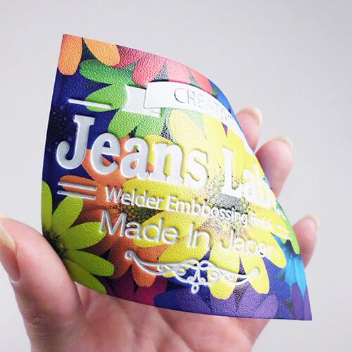 人工皮革 カラープリント+エンボス フラワー柄