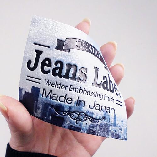 人工皮革 カラープリント+エンボス 都市柄